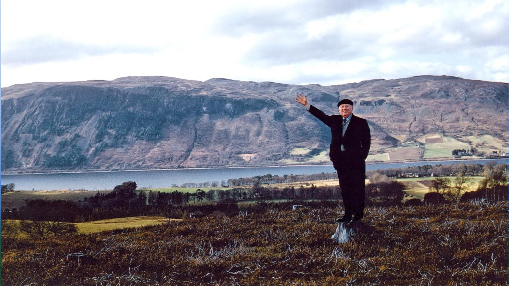 Hughston McBain 21st chief of Clan McBain circa 1961. Standing on the memorial spot of the park with the town of Dores and Loch Ness in the backgrond.